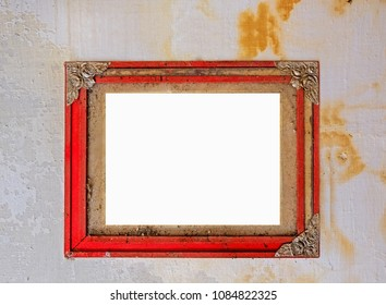 old stained wooden frame on grunge wall