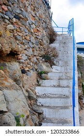 old stair built in the rocky wall near the port of Sissi on Crete in Greece
