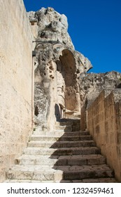Old stairs among rocks of Sassi or stones of Matera European capital of culture 2019, Basilicata, Italy, vertical