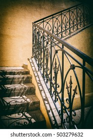 old stairs of concrete outdoors, black steel railing with a yellow wall, perspective, city, architecture,  retro style