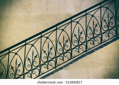 old stairs of concrete outdoors fragment, of black steel railing with yellow walls, perspective, city, architecture,  retro style