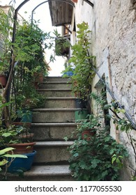 Old stairs of house in Calcata, Latium, Italy, offering a picturesque view.