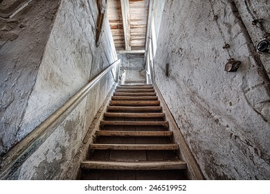 Old stairs inside a forgotten home