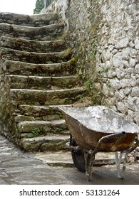 old stairs with wheelbarrow