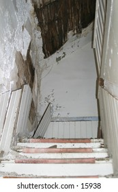 An old stairway to an abandoned farm house.