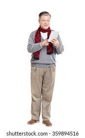 old standing Asian man in grey jumper and scarf holding tablet