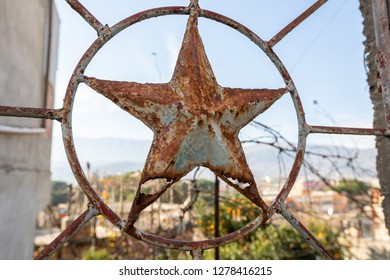 old star in rusty iron heirloom of the Albanian communist regime