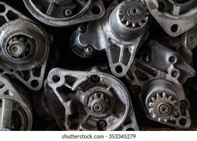 Old starter motor car on shelf