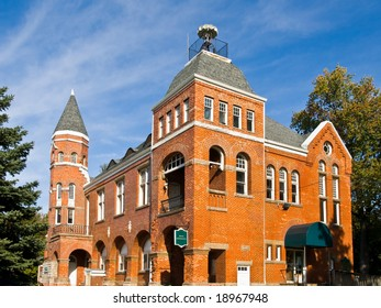 Old stately building against a vibrant blue sky