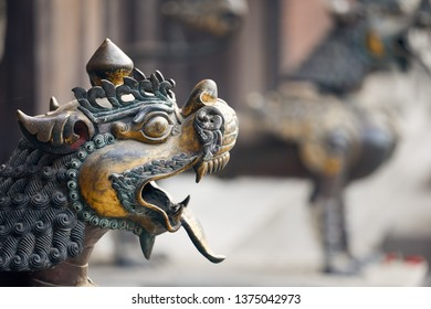 Old statue of dragon in Buddhist temple of Kathmandu, Nepal