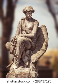 Old statue on grave in the Lychakivskyj cemetery of Lviv, Ukraine.