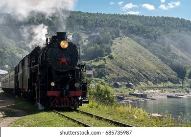 The old steam locomotive is driving along the Circum-Baikal Railway