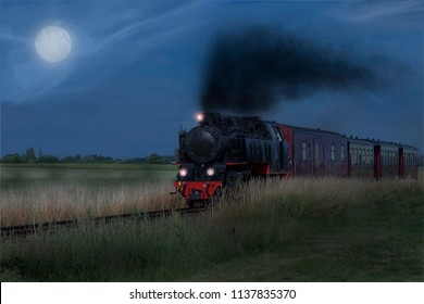 old steam locomotive at night at full moon