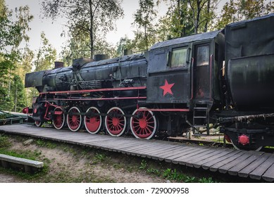 Old steam locomotive with Soviet star in regional promotion park in Szymbark, Poland