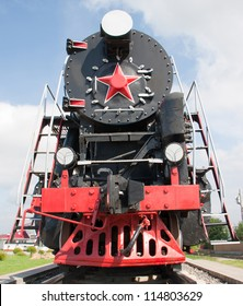 The old steam locomotive stands on rails