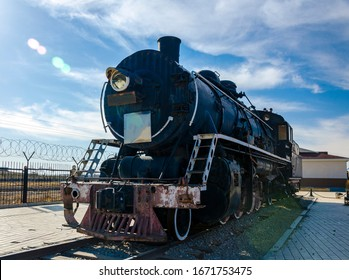 Old steam locomotive under blue sky