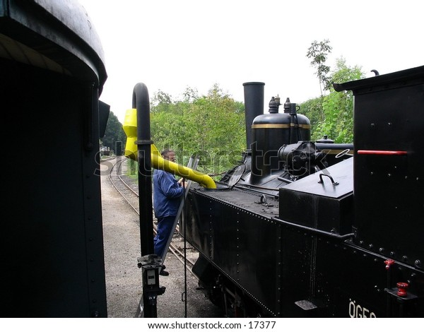 Old steam train fills with water