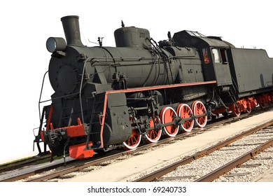 Old steam train isolated on white