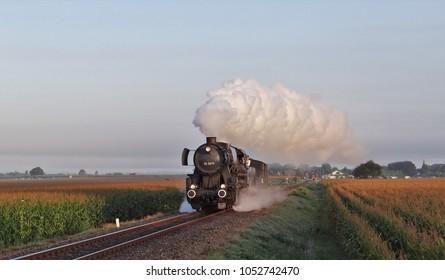 An old steam train with a nice smoke plum in the Netherlands