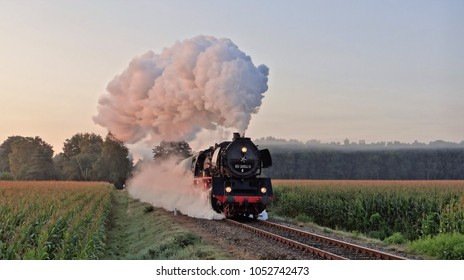An old steam train with a nice smoke plum in the Netherlands in the morning