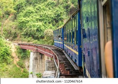 Old steam train ride over a bridge, view from a window, Nilgiri Mountain Railway, Ooty, Tamil Nadu, India