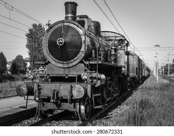 an old steam train stopped at the station