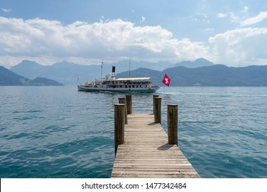 Old Steamboat on Lake Lucerne carrying passengers from Weggis to Brunnen on a bright sunny day.
