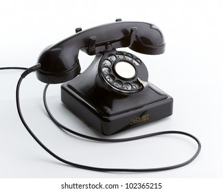 Old steel and bakelite telephone 3/4 to right on white background