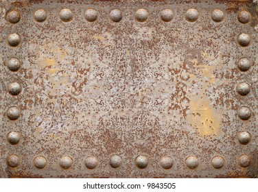 old steel plate with bright rivets