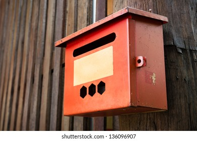 Old Steel Red Mail Box Hang on Wood Wall