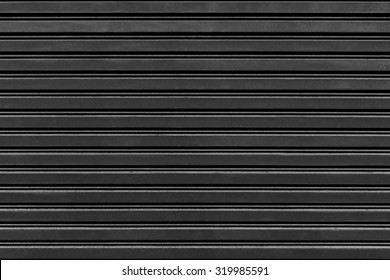 old steel rolling shutter background (black and white tone color)