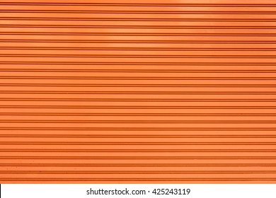 old steel rolling shutter background (orange color)