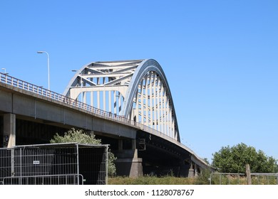 Old steel suspsension bridge over the river Lek at Vianen for highway A2 in the Netherlands.