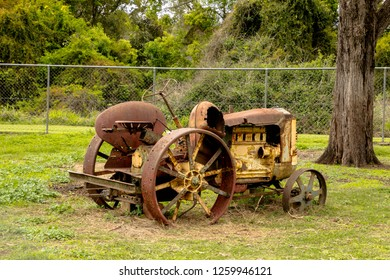 old steel tractor sitting in a field