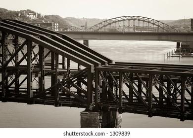 An old steel train bridge crossing a river. Taken in Pittsburgh, PA.
