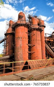 Old Steel Works against the blue cloudless sky