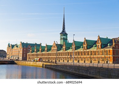 Old Stock Exchange along the canal in Copenhagen, Denmark. Former stock exchange building along the canal with a distinctive spire.
