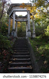 Old stone arbor with stairs in the park