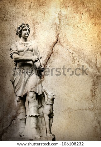 Old stone background with a sculpture man with dog