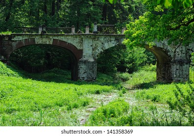 Old stone bridge in manor Serednikovo - recognized pattern of landscape and architecture of the 18th century, Russia