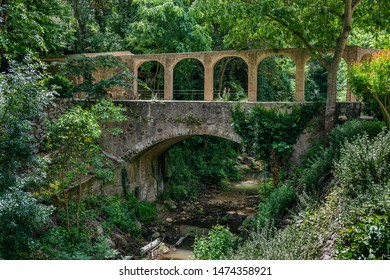 Old stone bridge over the river in the Park