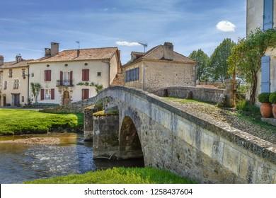 Old stone bridge in Saint-Jean-de-Cole village, Dordogne departement, France