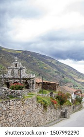 Old stone church in the Paramo de Merida, Venezuela on street with picturesque houses