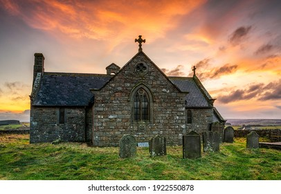 Old stone church at sunrise. Stone church cemetary. Ancient old stone church view. Church cemetery