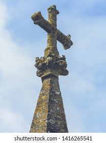 Old Stone Cross against Blue Sky, Portland Stone, Shallow Depth of Field Vertical Photography