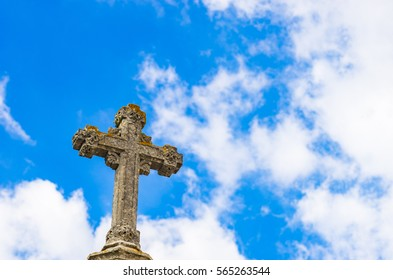 Old stone cross against the sky.