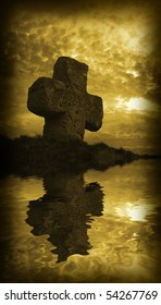 old stone cross on the background of a beautiful sunset