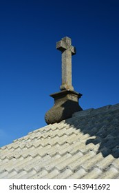 Old stone cross on the church