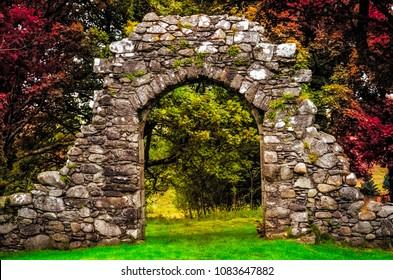 Old stone entrance wall in the garden with beautiful colorful foliage