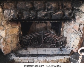 Old stone fireplace in the hunter house.